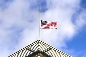 a flag flown at half staff to represent memorial day