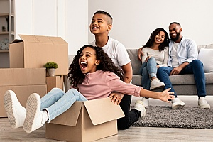 a family moving into an apartment after acquiring a Georgia renters insurance policy