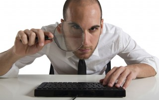 insurance agency buyer with magnifying glass