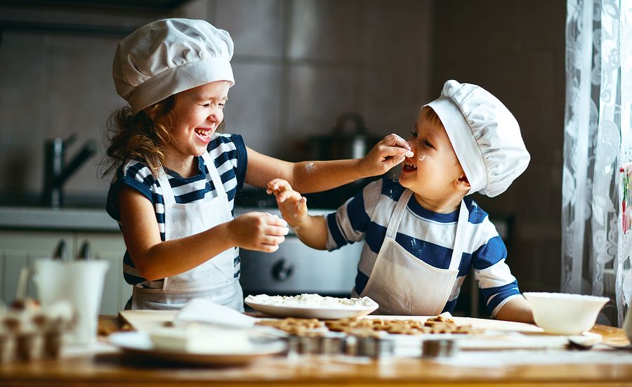 children playing and pretending to be bakers