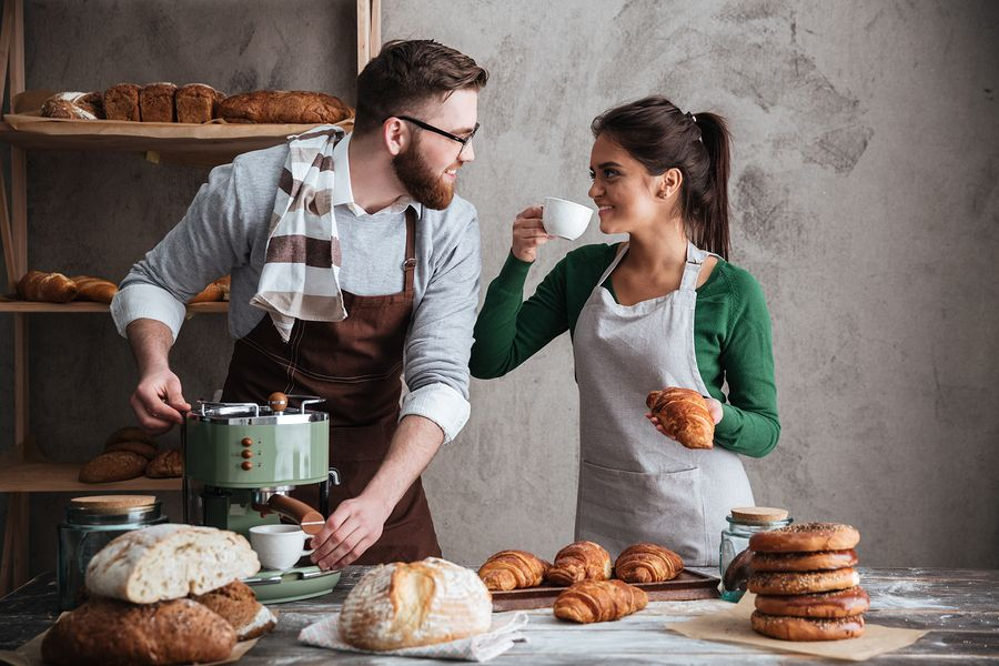 Bakery owners discussing bakery insurance