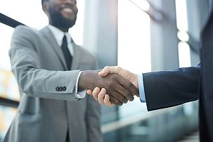 Agent and client shaking hands