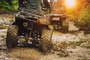 ATVs riding through mud