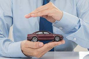 Car in hands protected with auto insurance