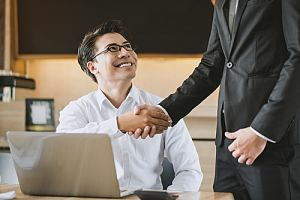 Company employees shaking hands