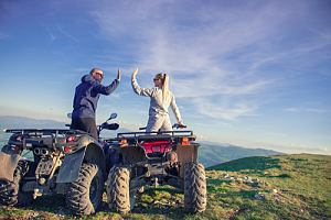 Couple celebrating on ATVs