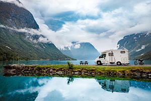 RV with RV insurance sitting by water