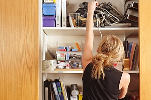woman taking inventory of what is in her house to determine how much insurance she needs