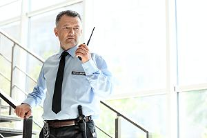 Armed security guard in stairwell