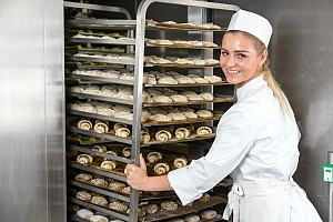 Bakery employee with baked goods