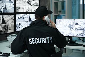 Security guard sitting at monitors