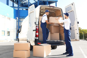 Employees loading items into vehicle