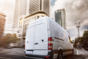 Commercial van driving through streets
