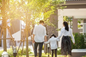 family walking to their home protected by  Home Insurance Douglasville GA