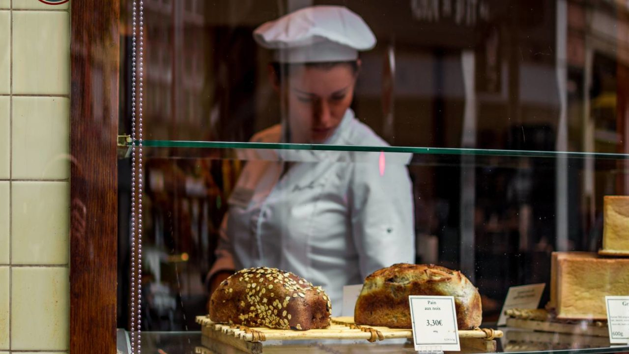 bakery owner assesses the products for the insurance policy