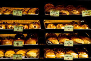 due to the cost of bakery insurance the bakery owner prices the goods accordingly