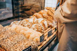 shopper checks out the cost of each bakery goods and is unaware of the insurance cost