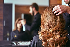 a woman visiting a salon that is covered by hair salon insurance