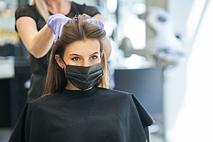 a woman wearing a mask while visiting a hair salon