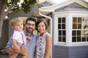 family outside their home with Home insurance McDonough GA