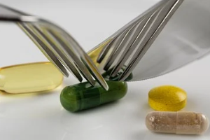 Eating Diet Supplements with Forks