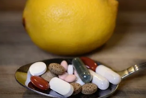 Supplements in Spoon with Lemon