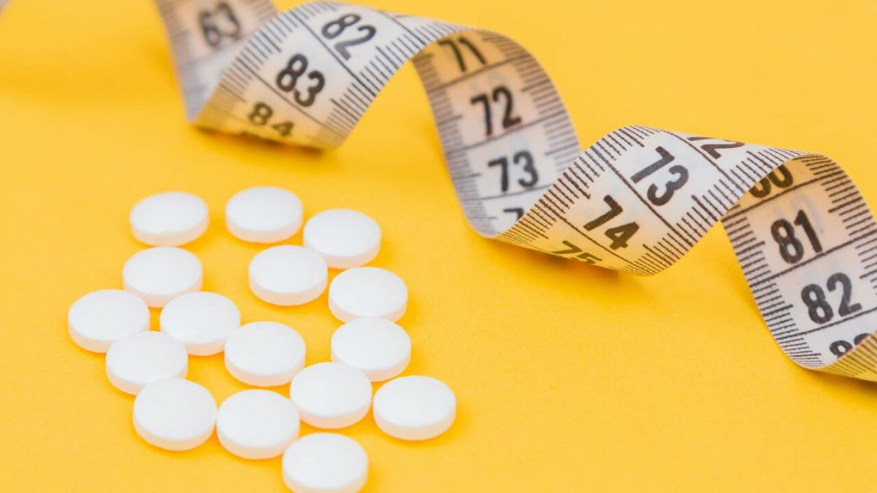 dietary supplement pills were placed close to the measurement tape after it was put under an insurance policy