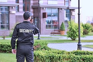 an armed security officer in uniform who is protected through an insurance policy