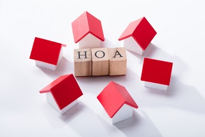 association wooden blocks surrounded with miniature house models