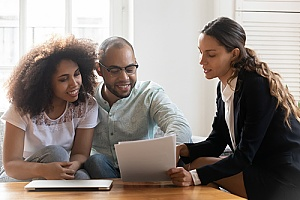 a couple discussing Georgia renters insurance with an insurance agent